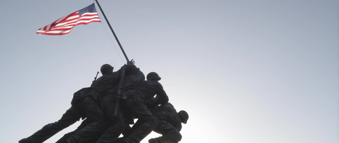 a statue of soldiers raising up a flag pole stock footage filmsupply