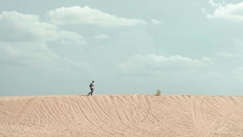 man in desert stock footage collection by spenser sakurai filmsupply