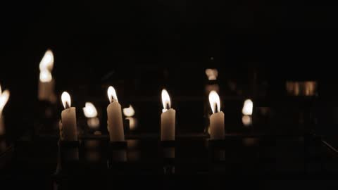 There Are Many Lit Candles In This Dark Room Stock Footage Filmsupply