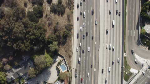 Cars travel on a highway overpass above the traffic and