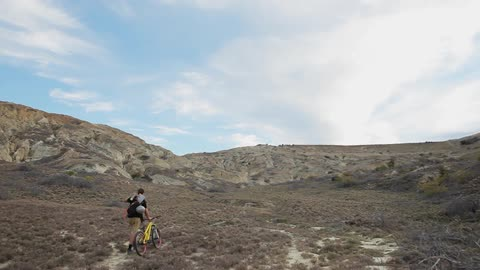 big bike jumps in the desert stock footage collection by two bearded