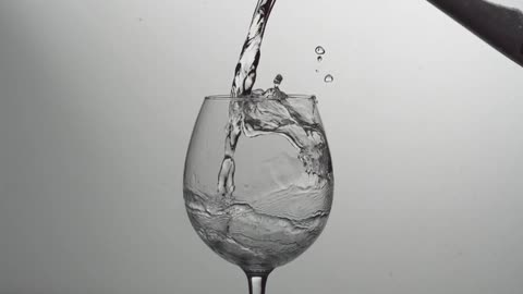 Liquid Being Poured Into A Wine Glass
