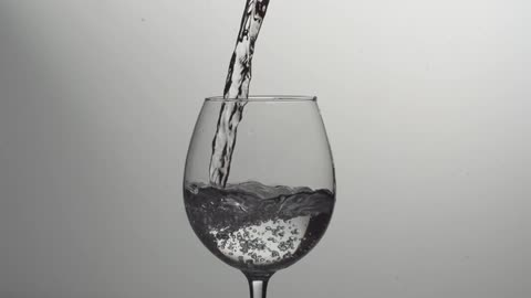 Liquid Being Poured Into A Wine Glass Stock Footage Filmsupply